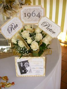 Party centerpiece - flowers and invitation for 50th anniversary