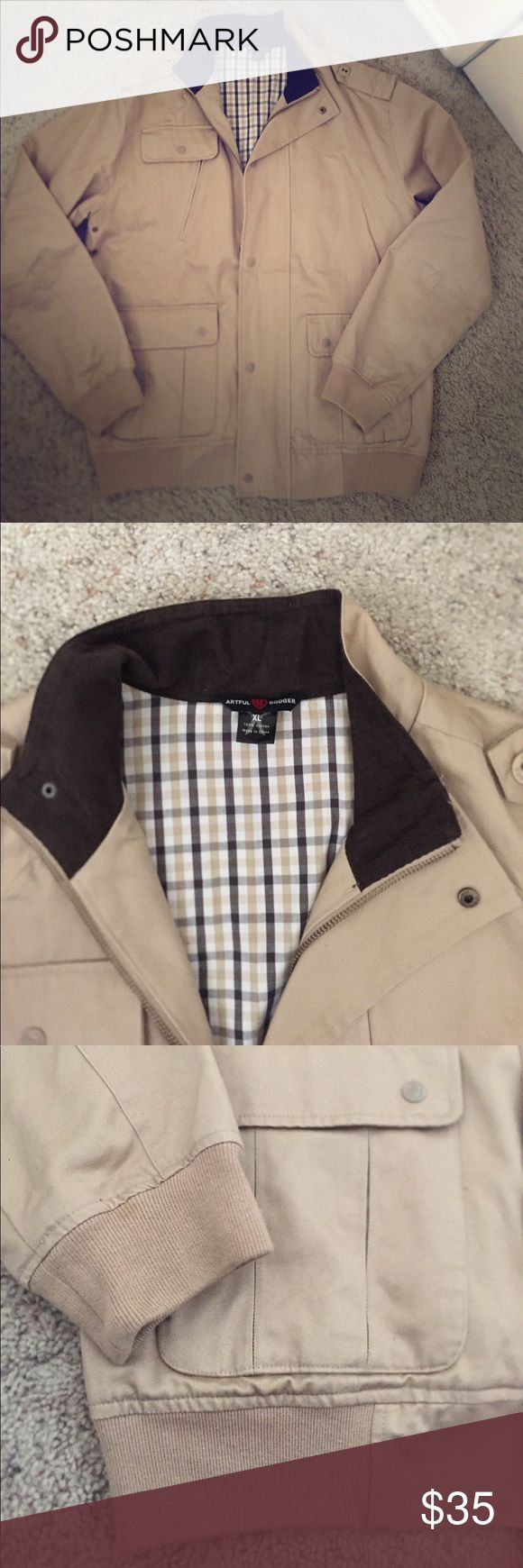 Men's ARTFUL DODGER Khaki Bomber Jacket Men's ARTFUL DODGER Khaki Bomber Jacket in size XL. Lots of pockets on the inside and outside. Zipper and snap button closures. In brand new condition! Artful Dodger Jackets & Coats Bomber & Varsity