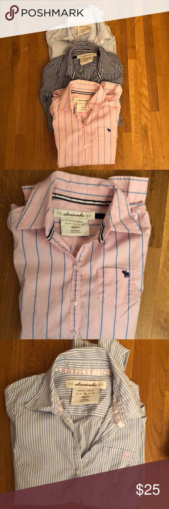 Three Abercrombie Girls' Button-down Shirts Medium Bundle of three classic Abercrombie girls' shirts in size medium. All with classic moose on pocket on front. One is blue and white stripes. One is pink with blue stripes. One is pink and blue stripes. Shirts are in very good condition. Abercombie Kids Shirts & Tops Button Down Shirts