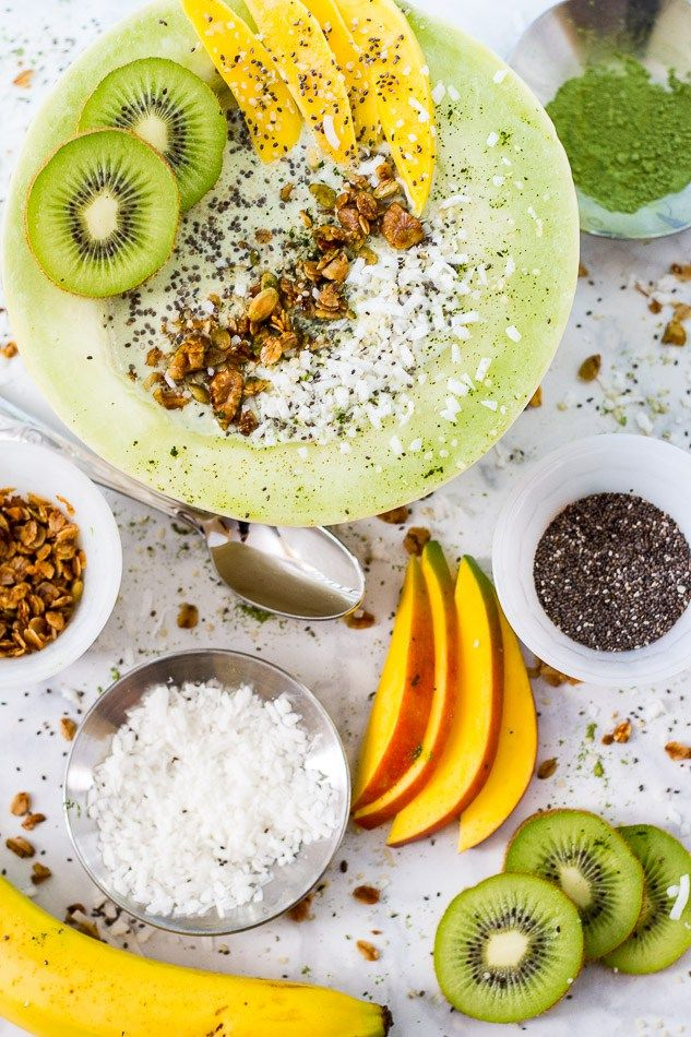 These Coconut Matcha Melon Smoothie Bowls are filled with mango chunks, kiwi, banana, matcha green tea and Greek yogurt for a filling and delicious breakfast!