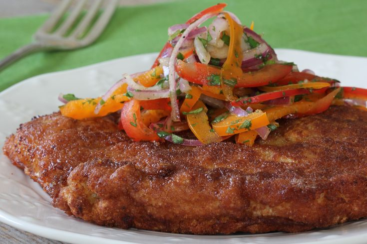 Take your pork chop game to the next level. Get creative and top pork chops with anything from citrus to pesto, and anything in between – we're going with a salsa of onions, sweet peppers and bright lime juice.