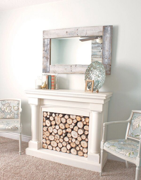 Open fireplace fire surround with logs for show
