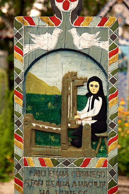 Hand painted wooden tombstone of a weaver at Merry Cemetary in Romania