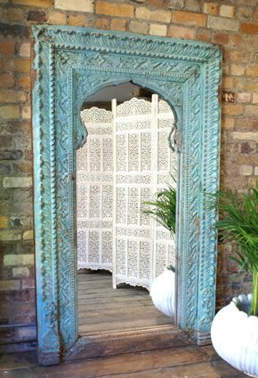 wall mirror, that color against exposed brick... Stunning!
