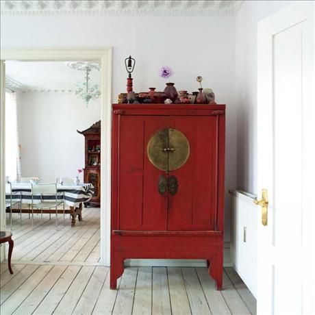 Heirloom Asian Antique Cabinet - this blends beautifully with your round red ottoman, chesterfield and rug.