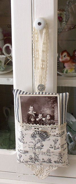 A lacey pocket displays a vintage family photo...so cute.