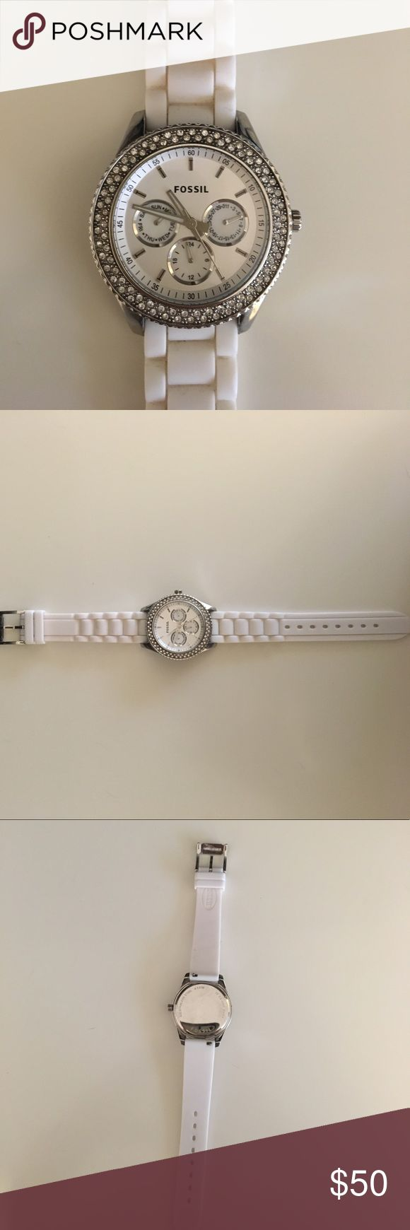 Fossil watch Sporty and sophisticated with a stainless steel case and white convertible silicone strap. Comfortable to wear. **Needs a battery replacement** Fossil Accessories Watches