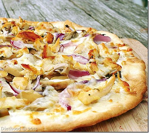 grilled pizza with cream cheese, chicken, and red onions