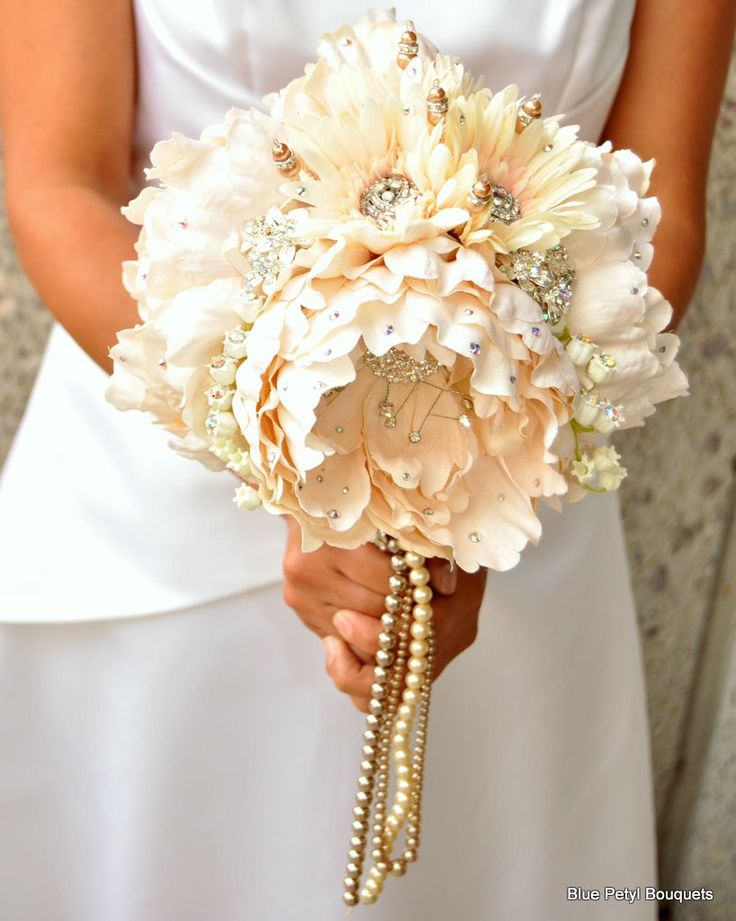 Mixing silk florals with the brooches on the bridesmaids' bouquets might save a little money.