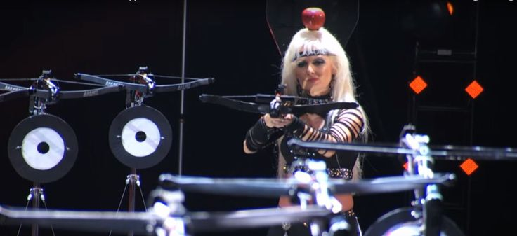 Granny Shoots Apple on Her Own Head  A 60-year-old grandma does a dangerous Crossbow Act. See her shoot multiple arrows at herself.. Now this is an epic skill people..  www.howley.in