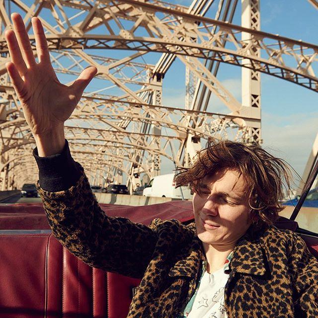 Paul Dano riding the Queensboro bridge in a 67 Mercury convertible. For Interview Magazine.