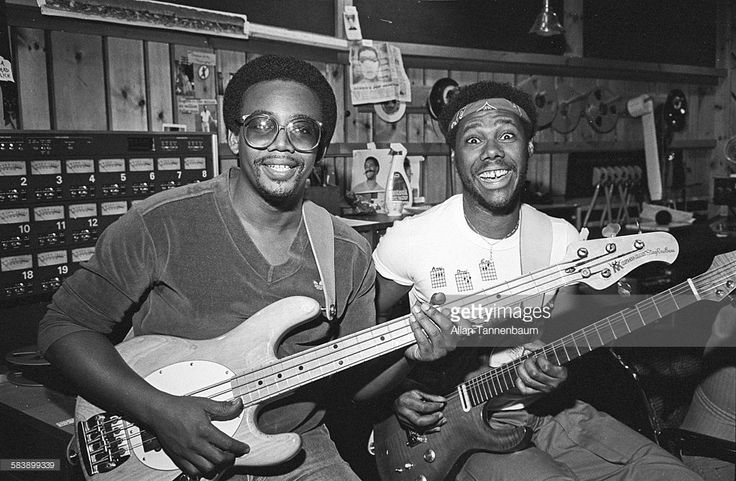 Bassist Bernard Edwards and Guitarist Nile Rogers, both of the group Chic, in a recording studio, New York, New York, July 29, 1981.