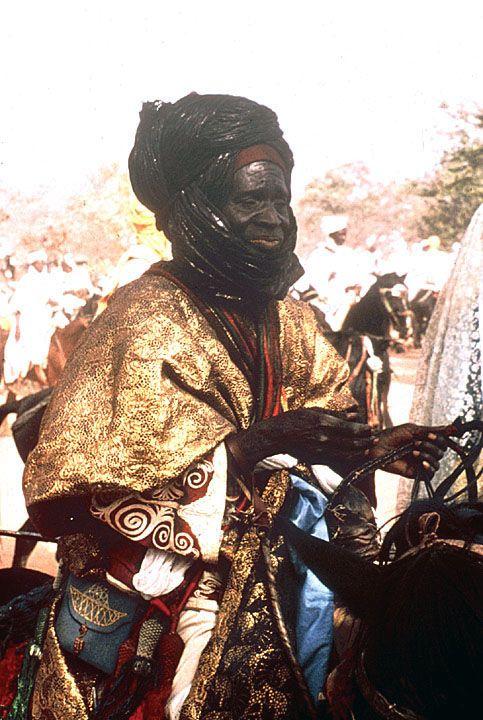 Africa | Man Dressed in Finery for Sallah (Eid el Kabir) Celebration after Ramadan.  Katsina, Nigeria.  1965. | ©Digital Library University of Wisconsin--Madison. African Studies Program. Photographer Jeanne Tabachnick