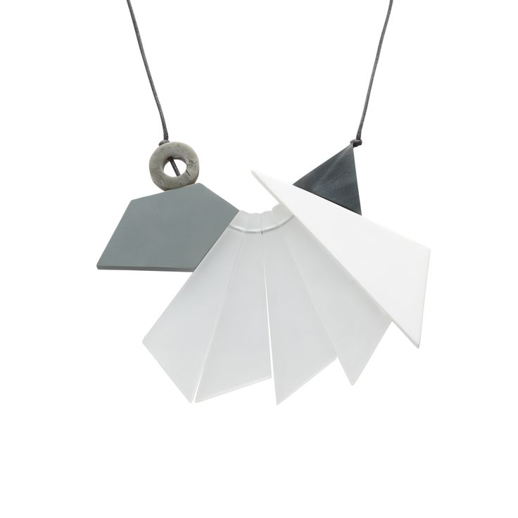 Buy the Lyra Statement Shapes Necklace at Oliver Bonas. Enjoy free worldwide standard delivery for orders over £50.