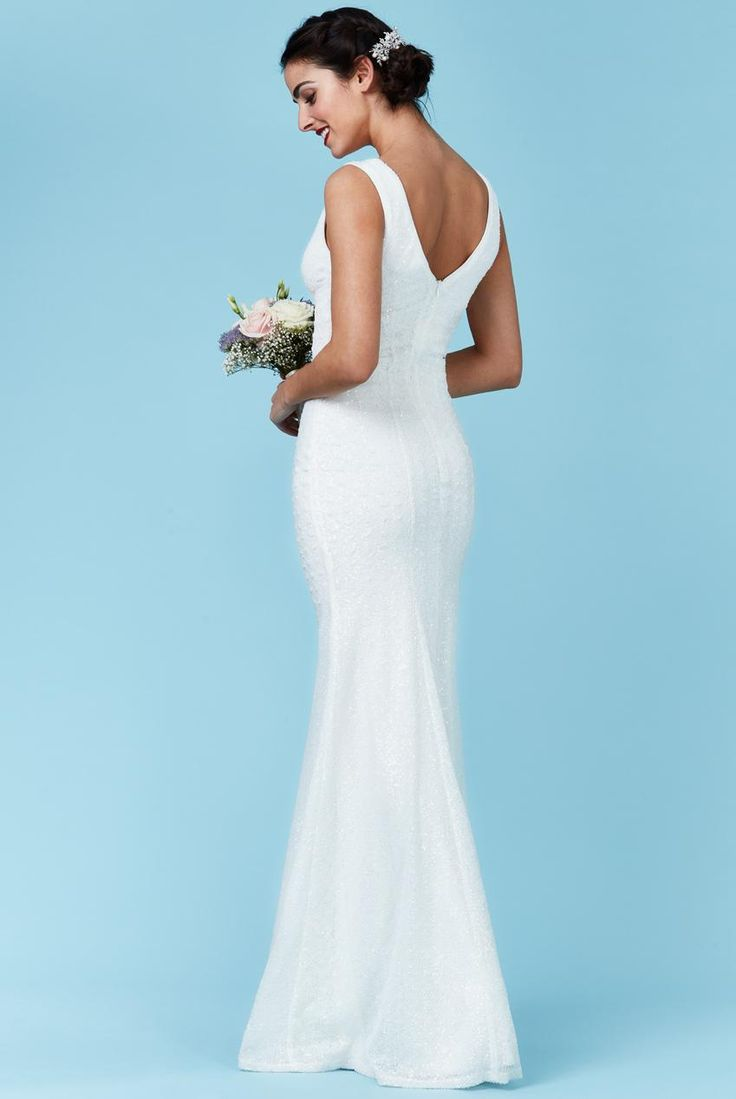 BG1702w now in store. Gorgeous off white sequinned gown. Low v neckline back and front. Perfect for many events.See more options on http://bridalandball.co.nz/formal-gowns/ball-gowns/. Follow us on instagram.com/bridal_and_ball/. Visit us in store in Albany village