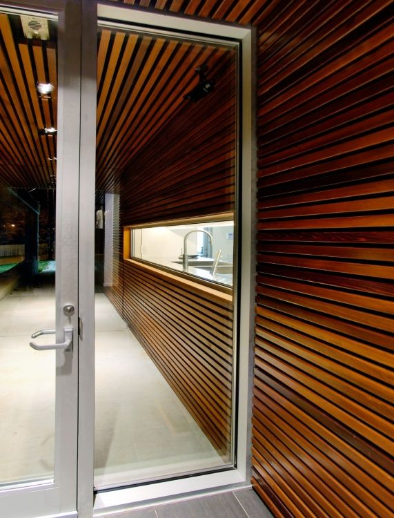 A dark finish on this cedar paneling is a dramatic and unexpected look indoors.  from Western Red Cedar Lumber Association
