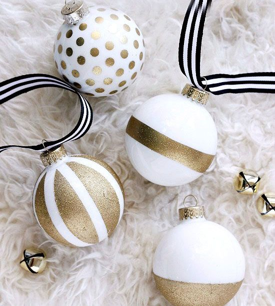 Create your own designer-style ornaments without the high-end price tag! The colorblock trend has been around for a while, but Cassie of Hi Sugarplum! uses it to spice up plain white ornaments with gold spray paint. /