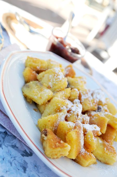 Hungarian Császármorzsa (sweet crepe crumbs)  -   A caramelized pancake is split into pieces while frying, shredded after preparation and usually sprinkled with powdered sugar, then served hot with apple or plum sauce or various fruit compotes, including plum, lingonberry, strawberry, or apple.