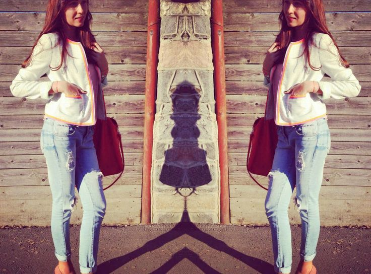 Roxanne: Ripped jeans and orange bag