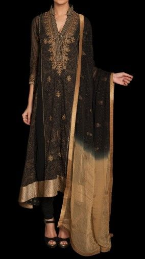 A black color A-line flared suit in poly chiffon with a sheer kurta and a long jersey inner, churidar and a dupatta.