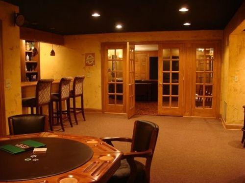 Man Cave Entertainment Ideas : Multi purpose basement man cave bar featuring seat