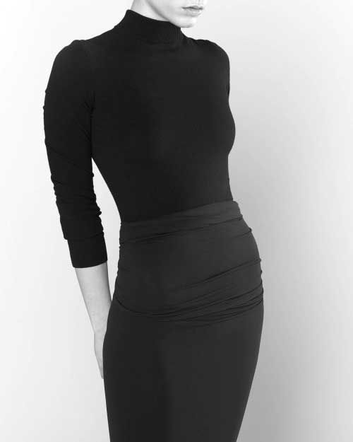A tutle neck or high covering neckline shirt or dress. Black would work best but any nuetral color is fine.