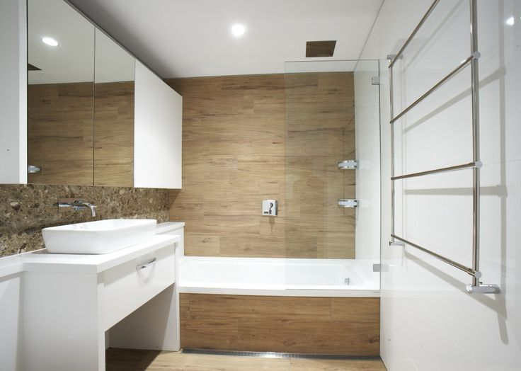 Timber look tiles and caesarstone pure white, maybe behind our freestanding bath in family bathroom?