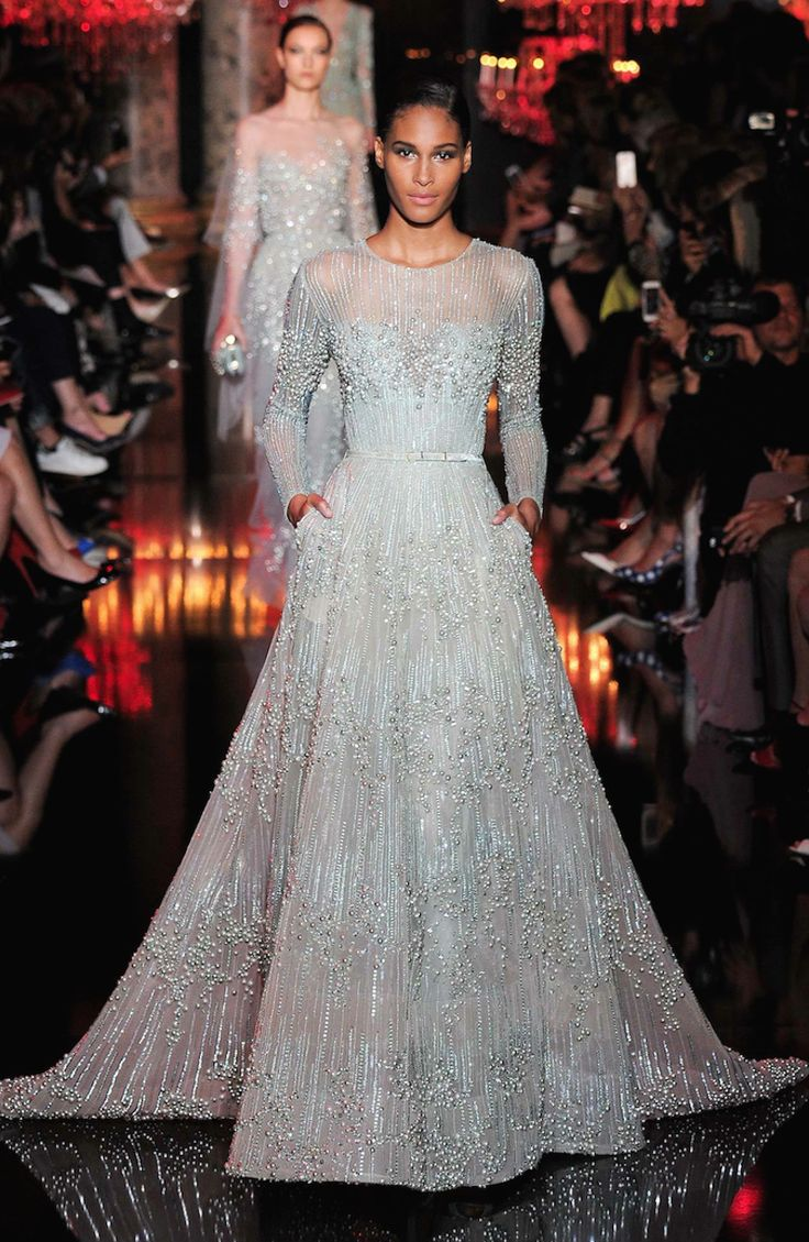 Elie Saab Fall 2014-2015 Couture...OMG absolutely gorgeous. Love the fabric. A simple silhouette with gorgeous fabric. Cheaper to have custom-made than purchasing from salon. Ask your seamstress for fabric suggestions that fit your budget.