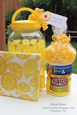 Yesterday during my quick trip (ha!) to Target I ran across the cutest lemonade container and the following idea came to life. I grabbed a package of matching lemon napkins, container of powdered lemonade mix, and some lemon drops...