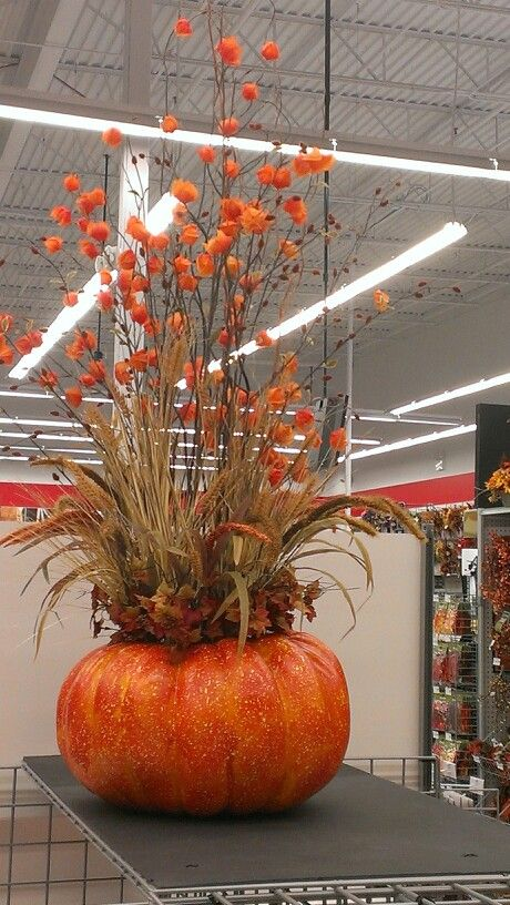 Large pumpkin with tall floral fall stems...Robin Evans