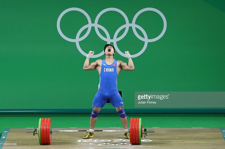 Xiaojun Lyu of China celebrates after lifting during the Men's 77kg Group A weightlifting contest on Day 5 of the Rio 2016 Olympic Games at Riocentro - Pavilion 2 on August 10, 2016 in Rio de Janeiro, Brazil.