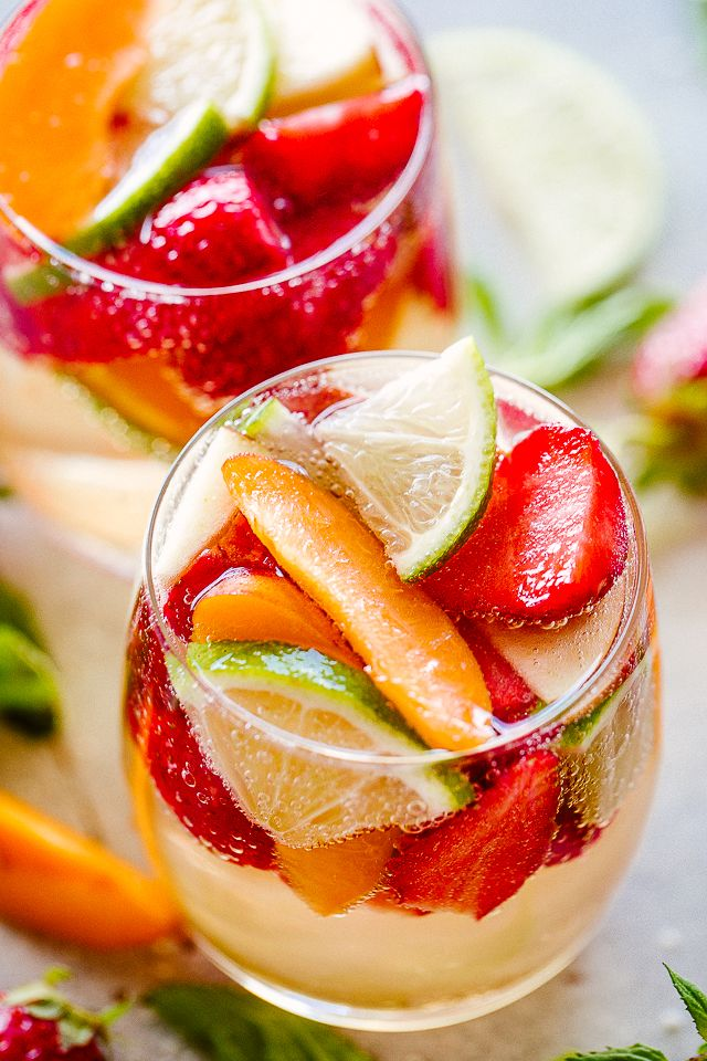 Easy White Wine Sangria Crisp Delicious And Bright White Wine Sangria Loaded With Fresh Summ White Wine Sangria Summer Sangria Recipes Easy Sangria Recipes
