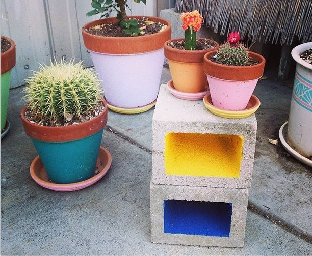 Painting the inside of cinder blocks. would look nice when making cinder block shelves - OR line with shelving contact paper!!
