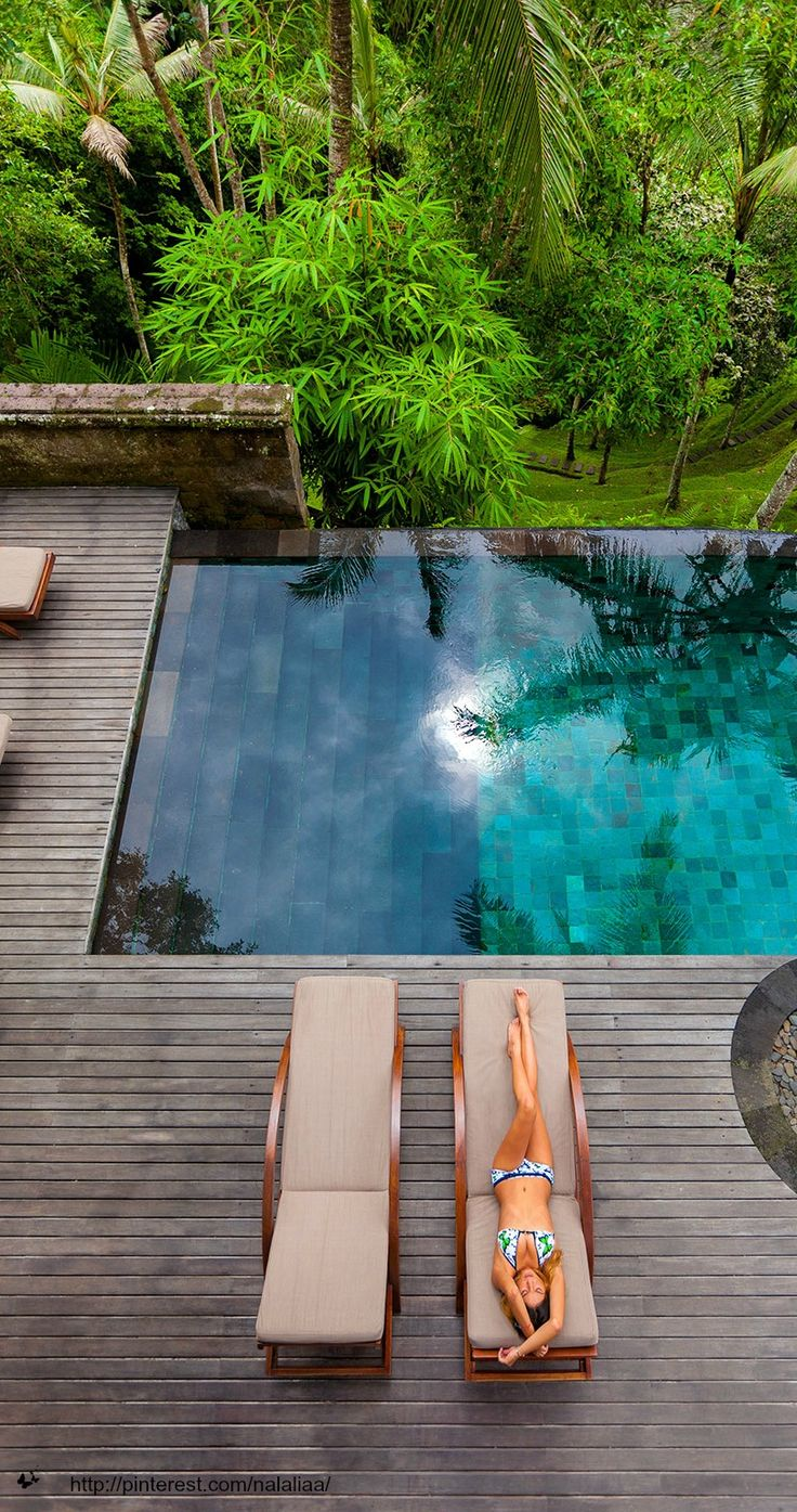 pool in the jungle with wooden porch