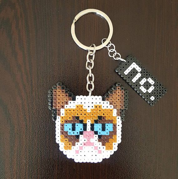 Nope. No description is needed. This listing is for 1 (one) keychain. The Grumpy cat keychain is made with mini beads. Choose your finish: keychain or fridge magnets. Grumpy cat size: 6 x 6 cm (2,36 x 2,36 inches) Keychain total length: 11,6 cm (4,56 in) IMPORTANT NOTE: If you want