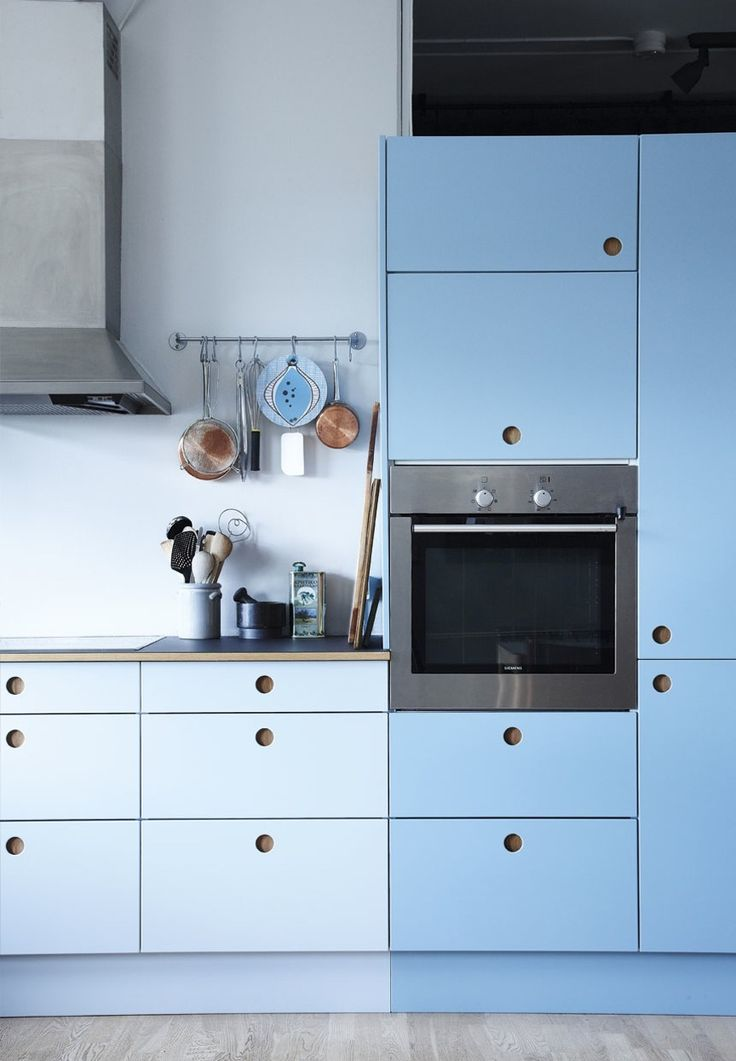 Colorful Kitchen By Reform With Cabinets In Blue Tones And Customized  Wooden Grips.