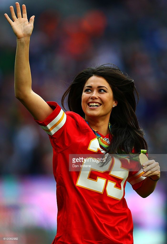 Olympic gold medalist Sam Quek of Great Britain poses with her medal during the NFL game between Indianapolis Colts and Jacksonville Jaguars at Wembley Stadium on October 2, 2016 in London, England.