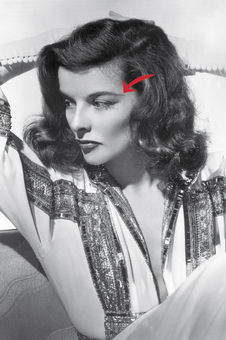 """Katharine Hepburn is using a tried-and-true makeup trick here. """"Lengthening the tail end of your brows lifts the eyes and adds drama to the face,"""" Scott says. Since Hepburn's a star on screen and stage, she goes for a theatrical length and height, aiming her brow at her temple. For an everyday eyelift, aim the tail at the upper ear, Scott suggests. Use a pencil like Maybelline New York Brow Precise, and don't go quite so far unless you're in fact a drama queen, too.   - HarpersBAZAAR.com"""