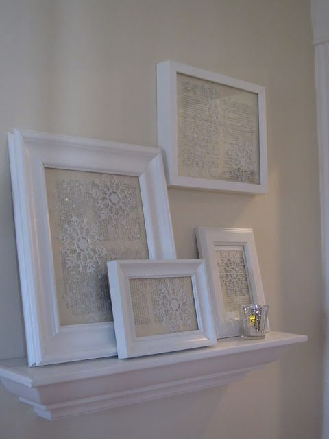 Dollar store snowflakes & vintage paper in frames. this gives me a GREAT idea for the wall behind my display-table!