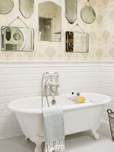 This claw-foot tub basks in the reflection of wall's worth of vintage beveled mirrors. #bathroomideas