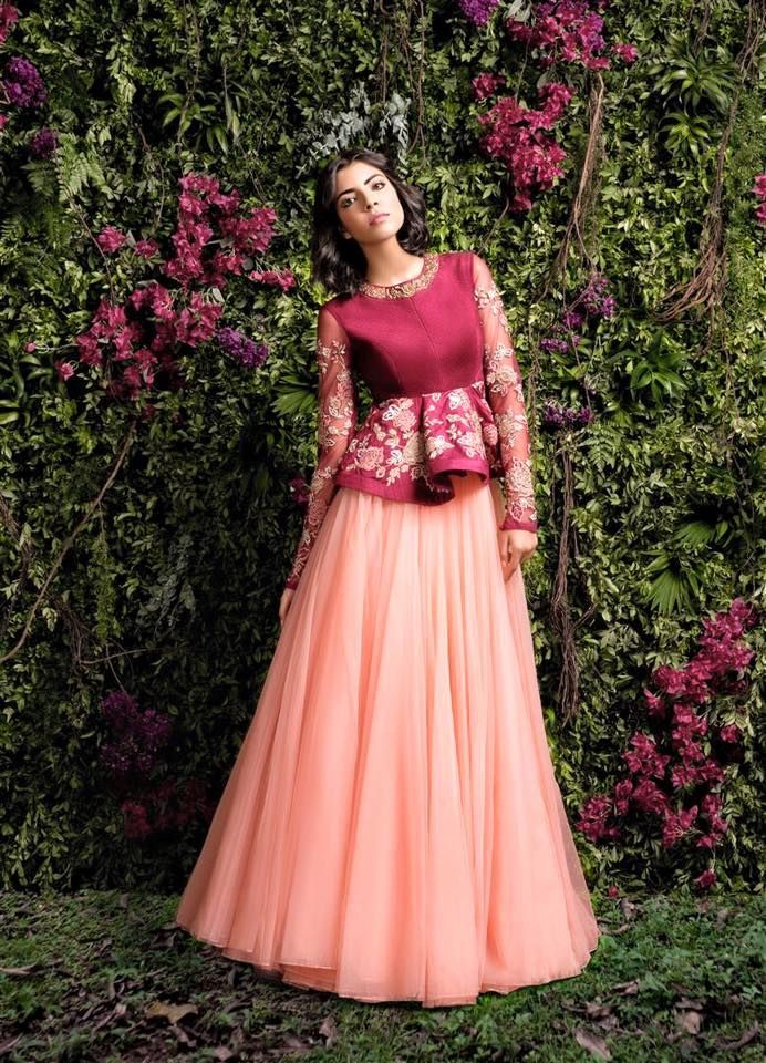 A wine red peplum with zardosi and tulle sleeves and a full tulle skirt, perfect for any bridesmaid in occasions like sangeet.