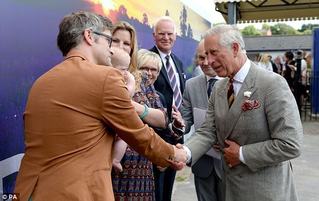 Prince Charles shakes hands with Calvin Jack's father Robin Etherington, 37, from Bristol  9 July 2014
