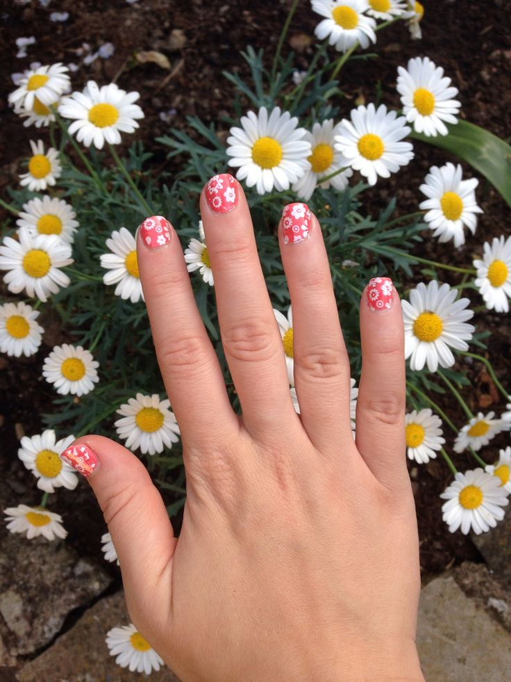 Coral with white flower nail art