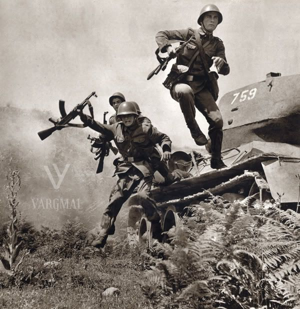 Albanian soldiers dismount from a T 34/85
