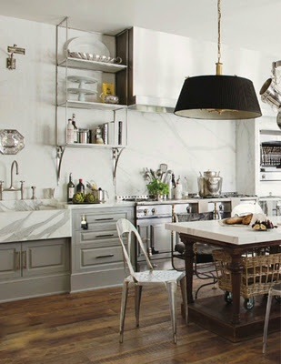 marble and cabinets...gold hardware (if it's not, that's what i'd want) and open shelves...i would put in a different island