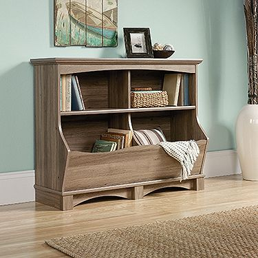 Cubbyhole storage for books, magazines, blankets, etc. Finished on all sides for versatile placement. Salt Oak finish.