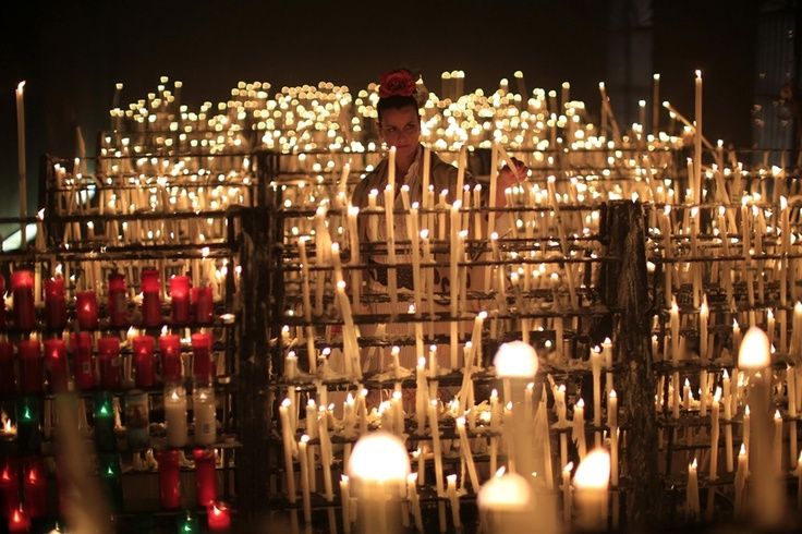 A pilgrim lights a candle in the shrine of El Rocio in Almonte, southern Spain.