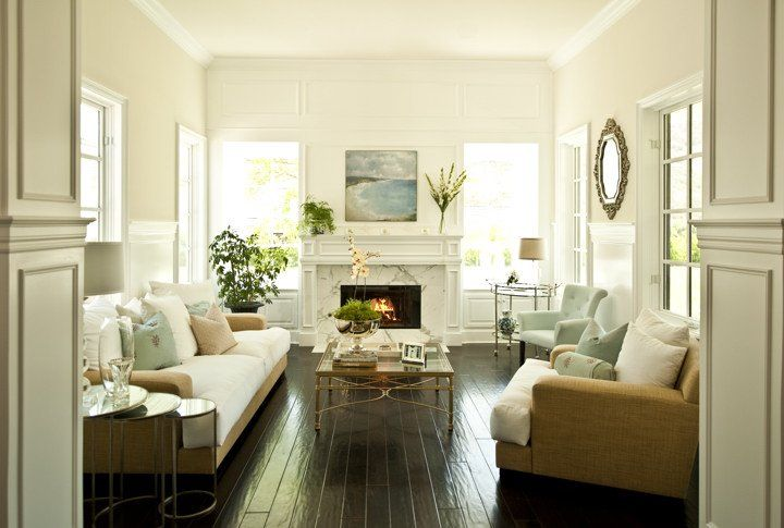 Beachy cottage living room design with white marble fireplace, ...