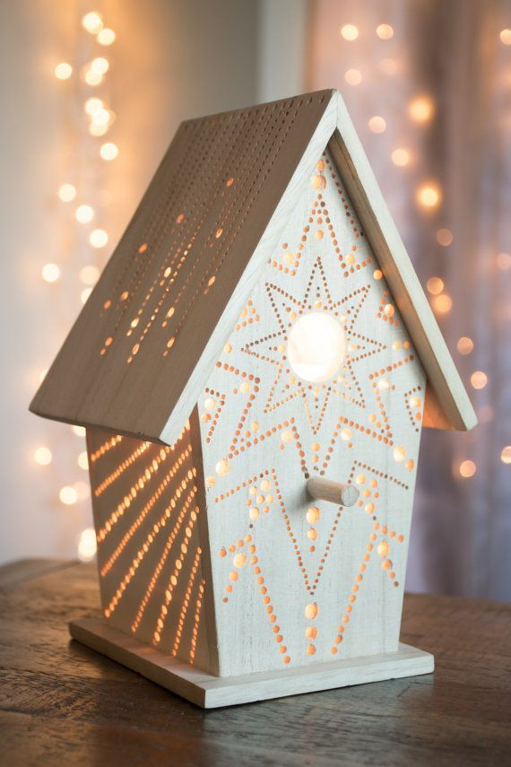 This little wooden birdhouse has been fitted with a 15w bulb and drilled with a one-of-a-kind pattern, drawn by hand. Its glow is soft and warm,