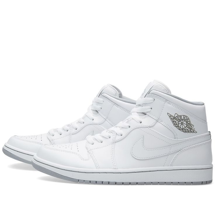 Delivering everyday comfort with iconic style, the Nike Air Jordan 1 Mid features premium leather uppers in an all white colourway, inspired by the original Air Jordan 1 that's been breaking records since 1985. Constructed with a perforated toe for breathability, the sneaker sits upon an Air-Sole unit for impact protection and a rubber outsole with deep flex grooves for traction and flexibility. Premium Leather Uppers All White Colourway Perforated Leather Toe Box Air-Sole Unit Rubber…